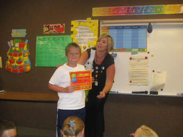 Sam receiving his 4th grade attendance award