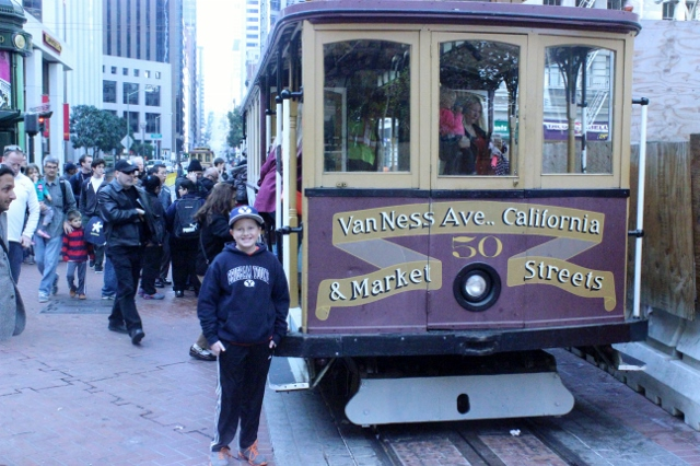 Sam riding the cable cars