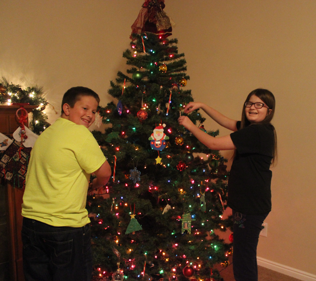 Sam and Caroline decorate the tree