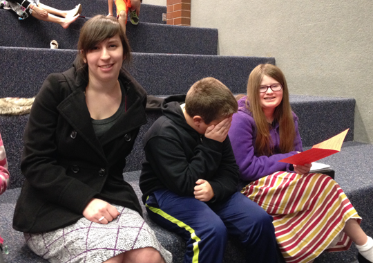 Rachel, Sam, and Caroline at the band concert